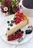 Piece of homemade honey cake with fresh berries