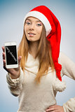 happy christmas girl showing smartphone