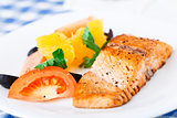 Salmon with oranges, tomatoes and olives
