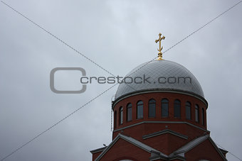 church dome with golden cross on it