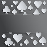 Background of four card suits symbols of paper.