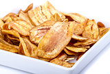 Crispy banana chip on white dish