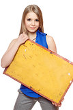 Young woman posing with yellow vintage board