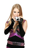 Young beautiful blonde holding a photo camera. Isolated