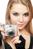 Young beautiful woman holding a photo camera