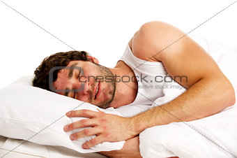 Man laid in white bed sleeping