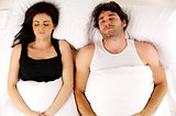 Man and woman laid in bed sleeping