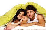 Beautiful couple in bed under a green duvet