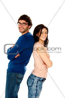 Beautiful couple stood back to back isolated on a white backgrou