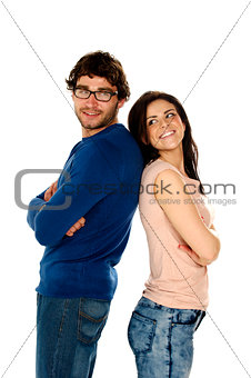 Beautiful couple stood back to back isolated on a white backgrou
