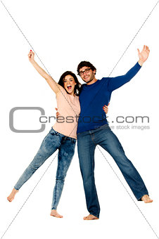 Beautiful couple cheering and celebrating isolated on a white ba