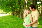 A young pregnant couple on nature