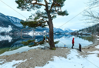 Alpine winter lake view and family.