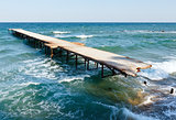 Ruined pier and evening Black Sea (Bulgaria).
