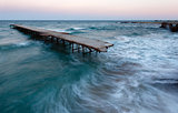 Evening sea storm and ruined pier (Black Sea, Bulgaria).