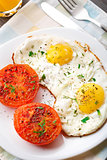 Breakfast with fried eggs and tomato