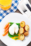 Poached egg with french beans and baked potato