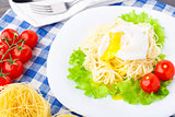 Delicious spaghetti with tomato and poached egg