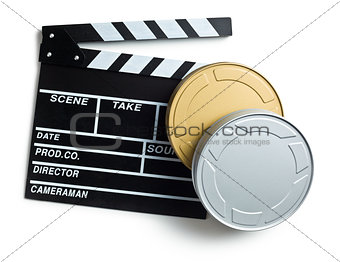 clapper board with boxes of film reels