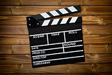 clapper board on wooden table