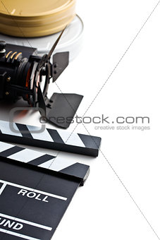 clapper board with movie light and film reel