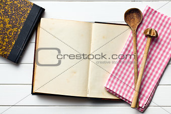 old recipe book with kitchenware