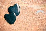 black stone hearts on old cracked background