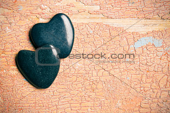 black stone hearts on old cracked background
