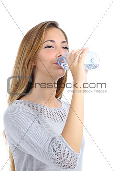 Beautiful woman drinking water from a bottle isolated