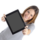 Top view of a woman showing a blank digital tablet screen