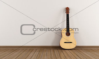 Acoustic guitar in a empty room