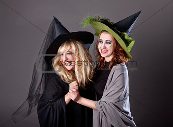 Two girls fool around at a party on Halloween
