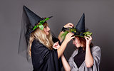 Two girls treated costumes of witches