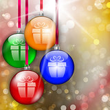 Hanging colorful Christmas baubles with gift sign