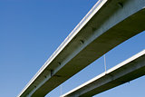 Pair of highway bridges on blue sky