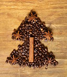 Christmas tree stylistic symbol of the coffee bean, cinnamon and star anise
