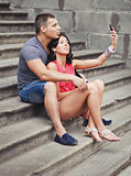 Romantic couple making picture of themselves