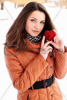 beauty holding a red heart