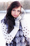 woman in a fur vest