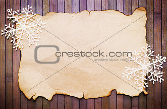 Old paper and decorative snowflakes