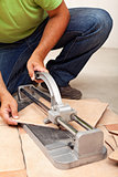 Worker cutting ceramic floor tiles