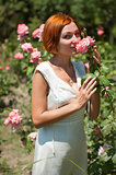 woman in roses garden.