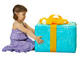 Girl with a big gift box on white background