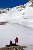Two hikers on halt in snow mountains
