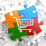 Shopping Cart Icon on Multicolor Puzzle.