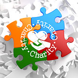 Charity Concept on Multicolor Puzzle.