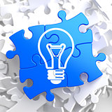 Light Bulb Icon on Blue Puzzle.