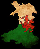 Wales grunge map outline with flag