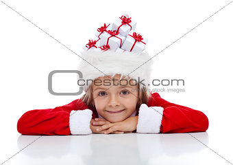 Christmas girl with lots of presents in her santa hat