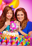 Girl with mother celebrate birthday